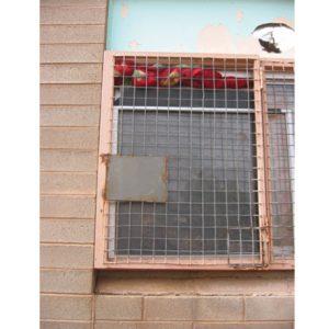 Broken window with blanket in top of window to exclude cold winds in winter